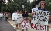 People carrying signs: Ferndale Housing is Racist