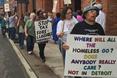 Marchers with signs like - Where will the homeless go? Does anybody care?